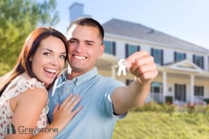 Married couple at home displaying their keys